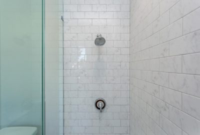 shower with marble tile
