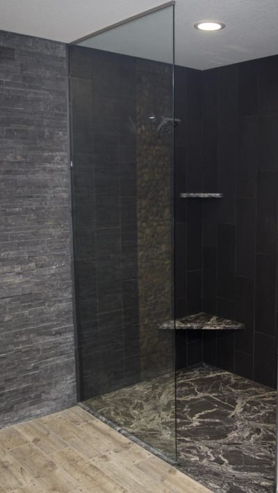 Custom walk in showers with granite shower floors