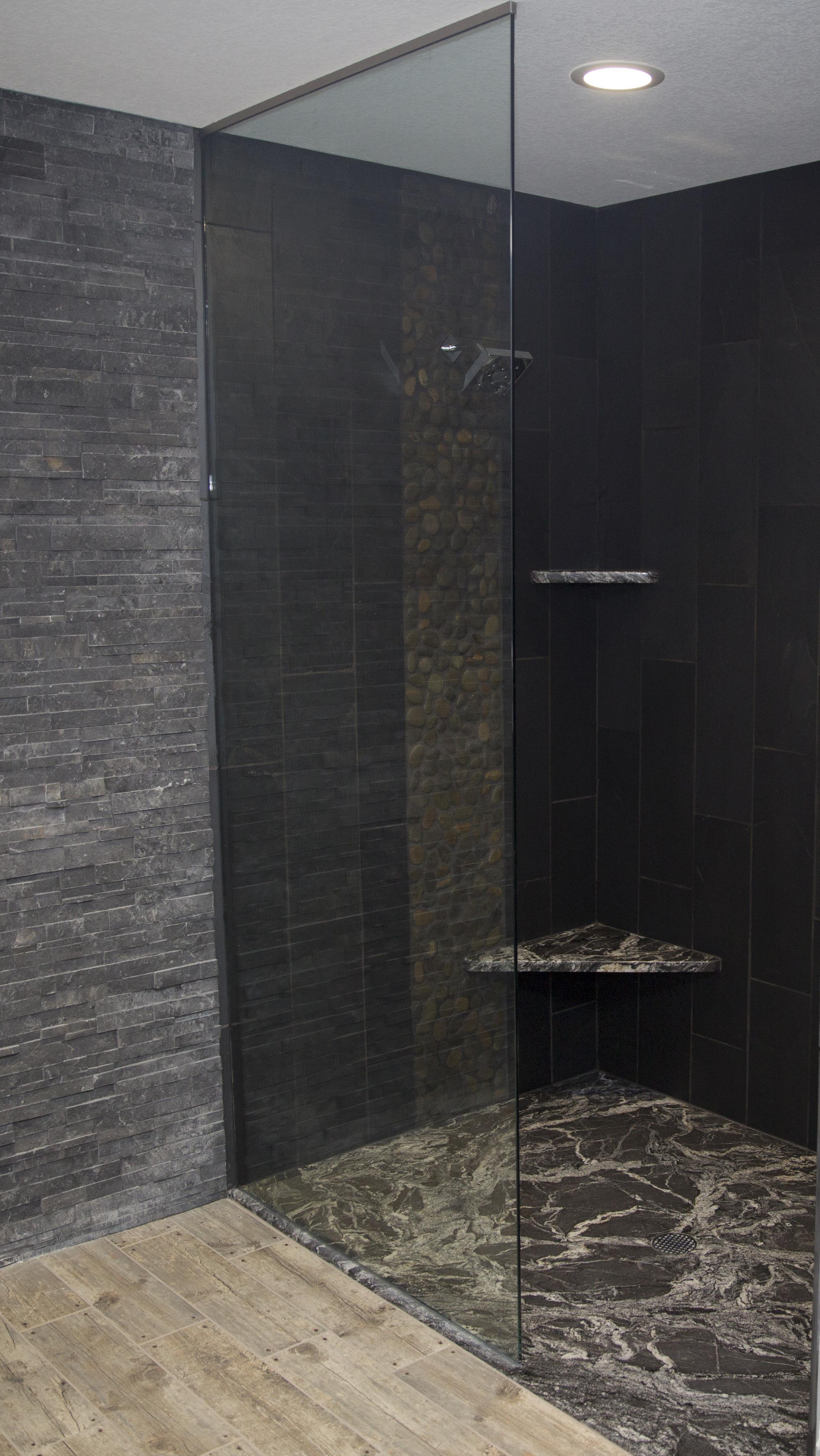 Custom walk in showers with granite shower floors