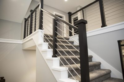 Stairway with custom built stainless steel railings