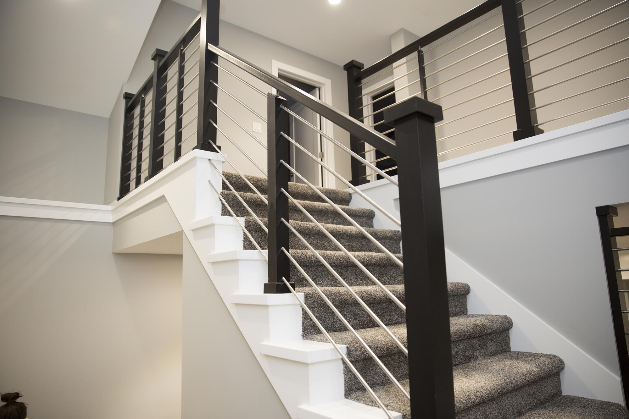 Stairway with custom built stainless steel railings